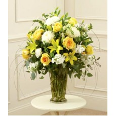 Yellow lillies and Roses in white at Alamo Heights Flowers and More