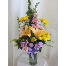 Yellow lillies in Pastels at Alamo Heights Flowers and More